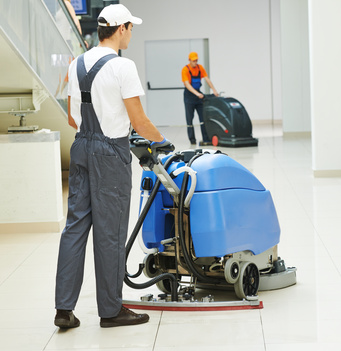 male worker cleaning business hall